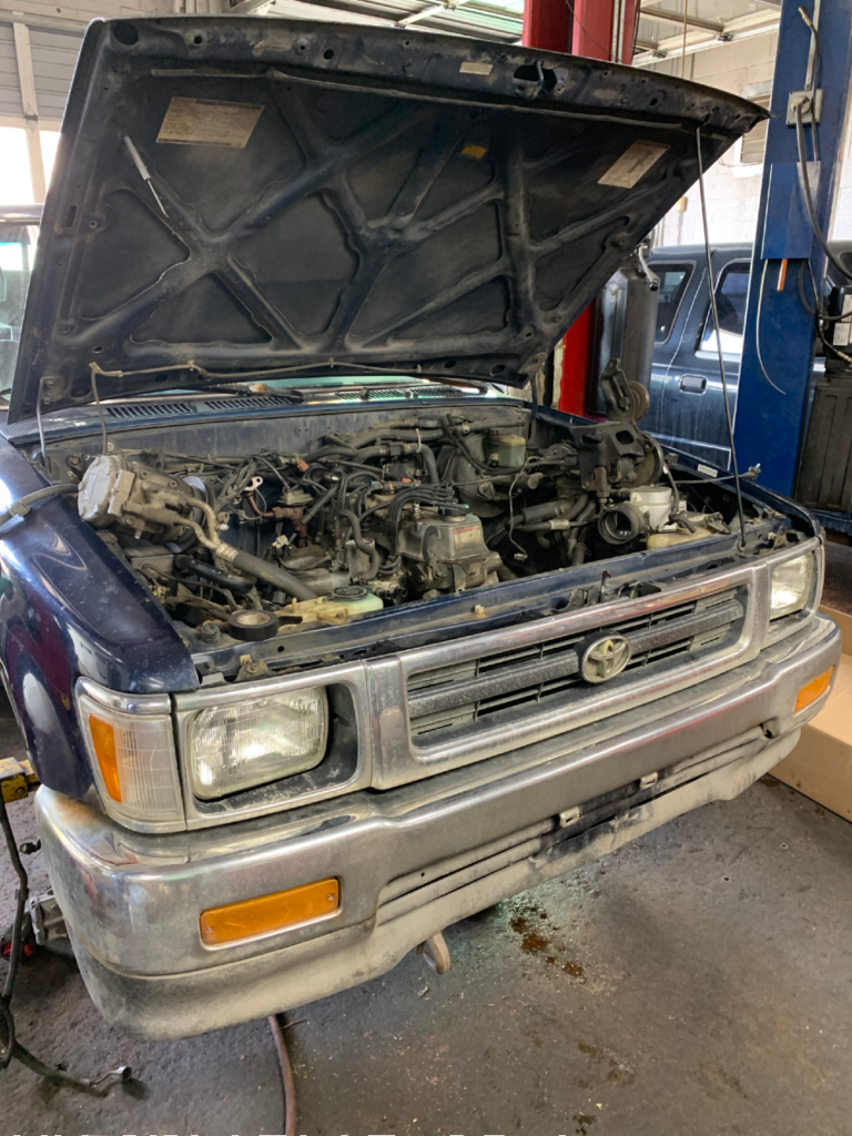 A look under the 1993 Toyota pickup hood