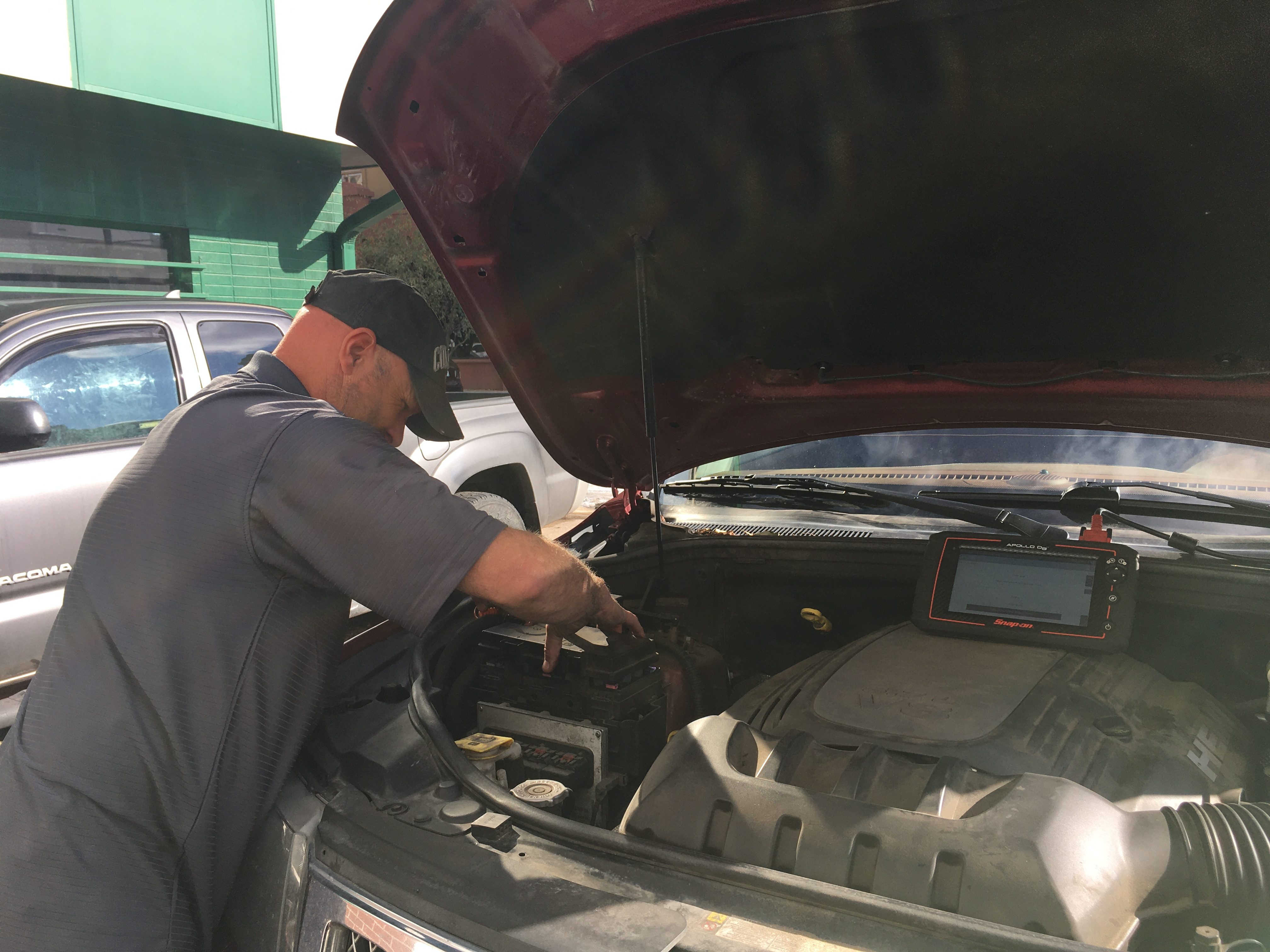 Dave working under the hood of a vehicle at Golden Triangle Auto Care