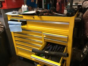 Yellow auto mechanic's tool box at Golden Triangle Auto Care
